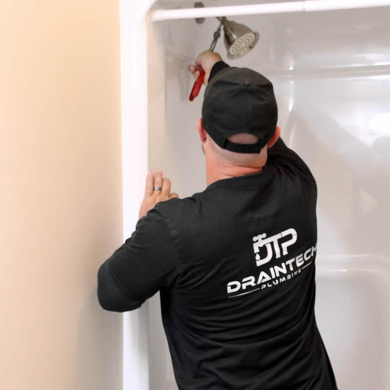 plumber fixing drains and shower